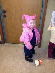 One of my favorite images of an empowered toddler: dressing herself (snow pants backwards, coat upside-down!) and so proud!